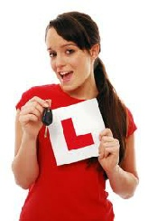 "Young lady with car key saying ""I Passed 1st Time"""